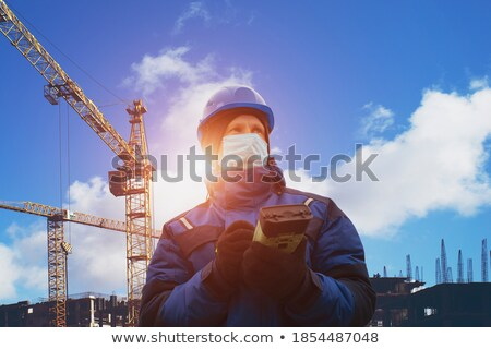 surveyor in front of blue skies stock photo © is2
