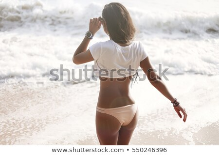 Happy slim tan women are dancing on the beach in sunset  Stock photo © dashapetrenko