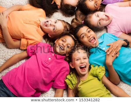 Many children lying down in circle Stock photo © colematt