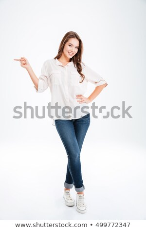 full length portrait of a cheerful blonde woman stock photo © deandrobot