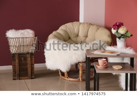 Soft fluffy plaid in the interior with flowers chair and cup of coffee Stock photo © ElenaBatkova