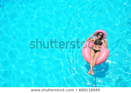 Inflatable tube floating in a swimming pool on a sunny day Stock photo © wavebreak_media