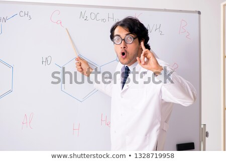 Young funny chemist in front of white board  Stock photo © Elnur