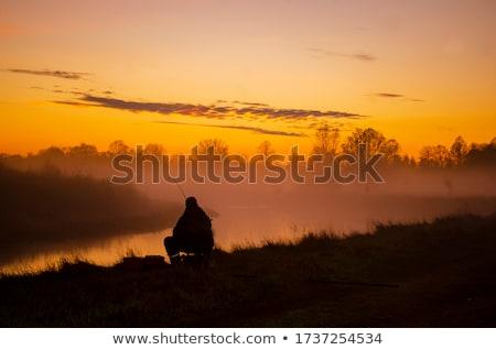 belo · pôr · do · sol · pescador · pescaria · pier · céu - foto stock © joyr