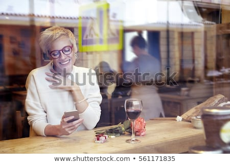 Blonde girl with present box at st. Valentine's day. Stock photo © Massonforstock
