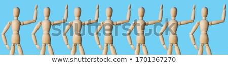 Wooden dummy with raised hands Stock photo © Taigi