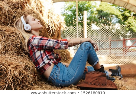 smiling young woman in a shed with rural interior stock photo © ruslanomega