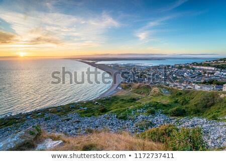 Weymouth beach sunset Stock photo © ollietaylorphotograp