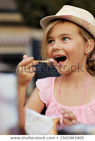 child is eating icecream at a outdoor table stock photo © meinzahn