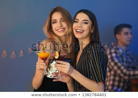 Girl drinking cocktail Stock photo © amok