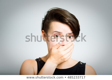 businesswoman with hand over her mouth stock photo © bmonteny