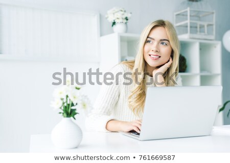 Elegant Pensive Woman with Flower in Office Space Stock photo © gromovataya