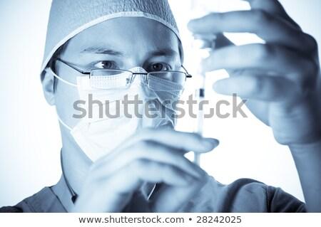 Ciddi doktor şırınga beyaz tıbbi kadın Stok fotoğraf © wavebreak_media
