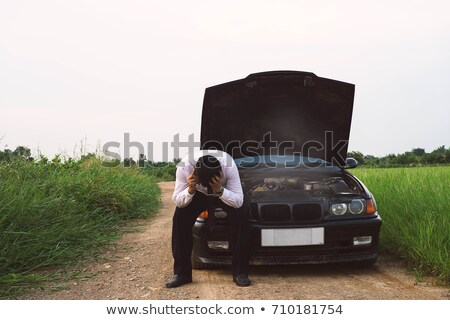 man  sits on the side of country road and smokes Stock photo © feedough