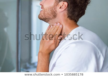 Doctor Checking Skin On Man's Neck Stock photo © AndreyPopov