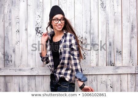 Hipster girl in glasses and black beanie stock photo © doodko