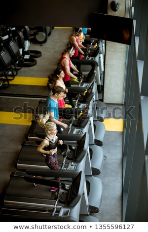 top view at young people running on treadmills in modern gym stock photo © boggy