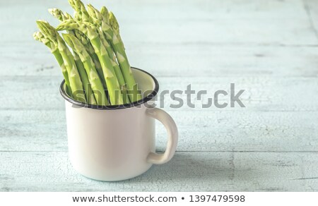 Bunch of fresh asparagus in the mug Stock photo © Alex9500