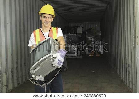 Trabalhador reciclagem reciclar centro como tv Foto stock © Lopolo