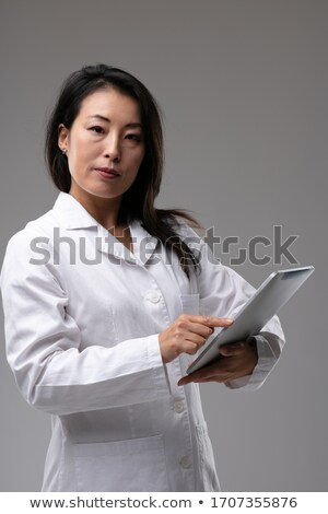 Female Asian doctor looking quizzically at camera Stock photo © Giulio_Fornasar