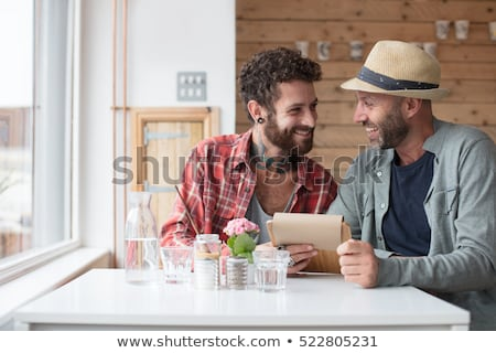 Couple sat closely Stock photo © photography33