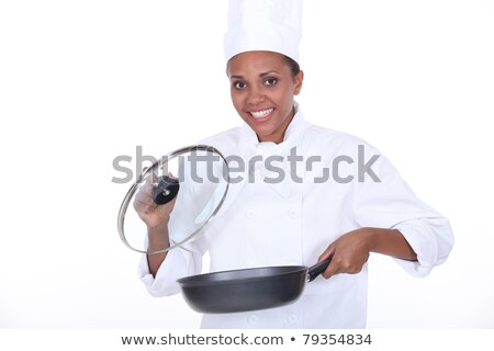 female chef exhibits a frying pan Stock photo © photography33
