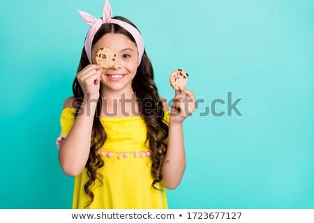Stockfoto: Portret · meisje · eten · biscuits · keuken · voedsel