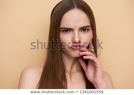 Woman puckering her lips Stock photo © photography33