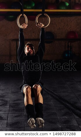 carries out difficult exercise, sports gymnastics with a dark ba Stock photo © dacasdo