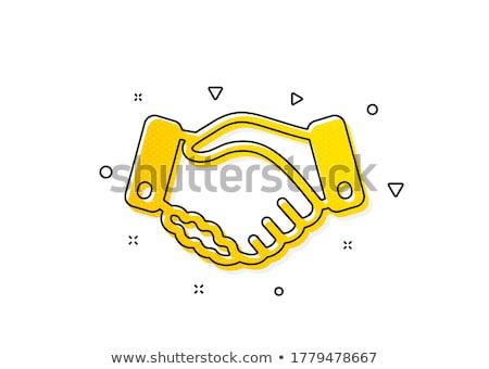 a yellow handshake stock photo © Nelosa