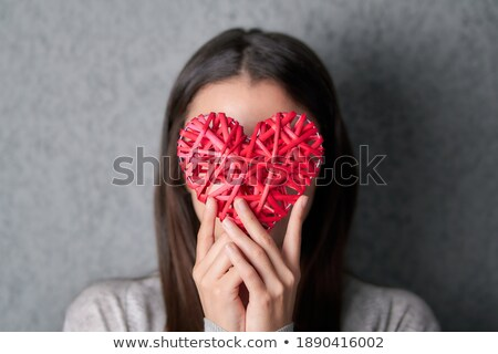 woman holding red heart in front of her face stock photo © rob_stark