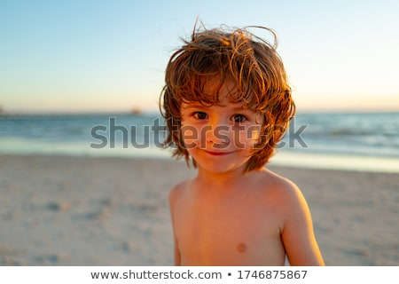 young boy enjoys the waves of the blue sea Stock photo © meinzahn