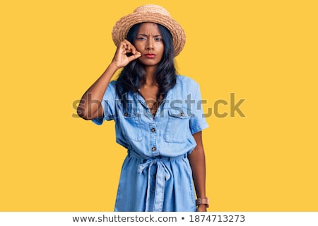 Indian young woman standing with finger on lips Stock photo © bmonteny