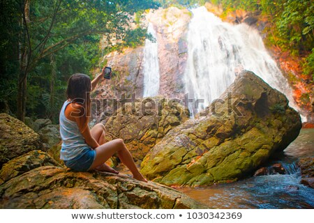 female hand with mobile phone waterfall stock photo © compuinfoto