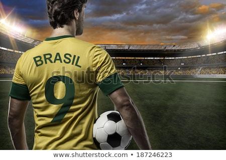 Futbolista amarillo ganar blanco feliz Foto stock © wavebreak_media
