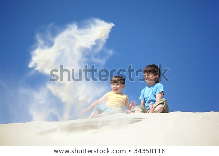 two boys sit on sand and scatter it Stock photo © Paha_L