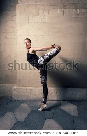 Woman stretching tank top against black background Stock photo © wavebreak_media