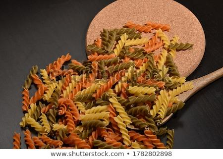 Brut pâtes cuillère blanche bois Photo stock © Digifoodstock