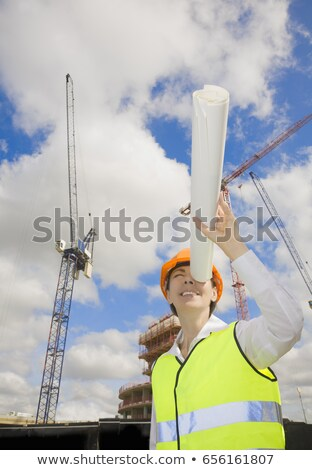 Woman Looking down tube at building site Stock photo © IS2