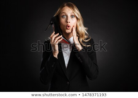 Businesswoman pretending to hold mobile phone Stock photo © wavebreak_media