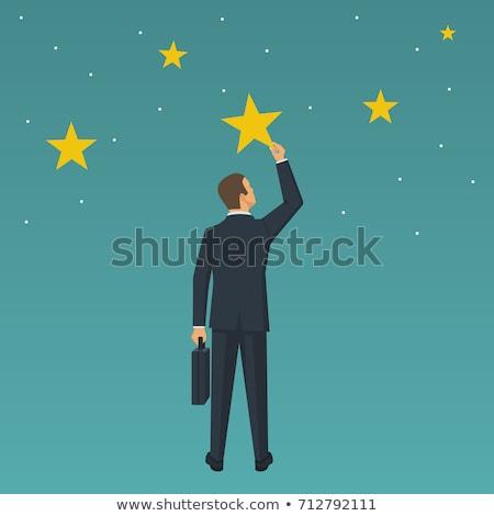 Big hand holds a businessman that achieves the success Stock photo © alphaspirit