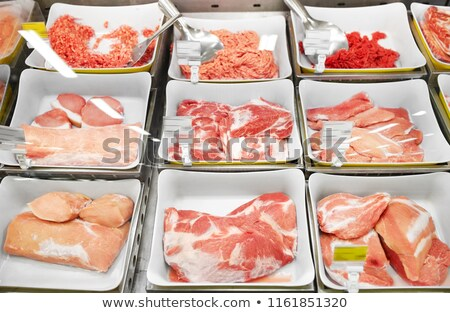 Stock photo: meat in bowls at grocery stall