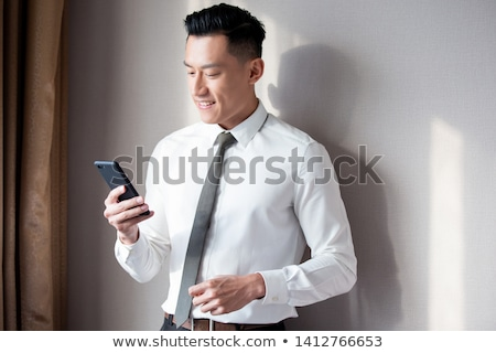 businessman with smartphone at office stock photo © dolgachov