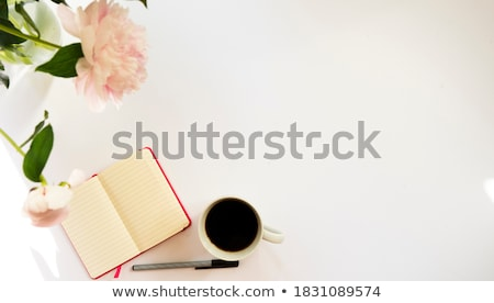 peony flowers on pink background with note or diary and cup of coffee stock photo © illia