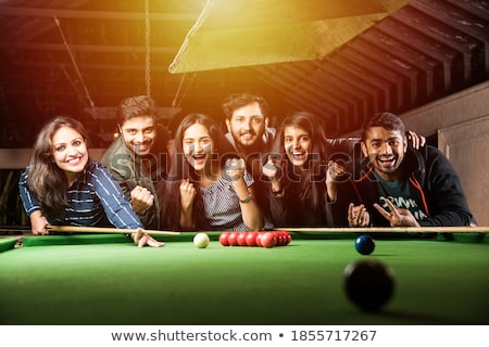 Young couple playing billiard Stock photo © Kzenon