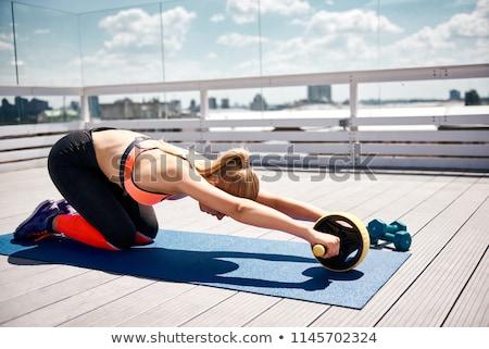 Mooie vrouw wiel jonge vrouw fitness training Stockfoto © Jasminko