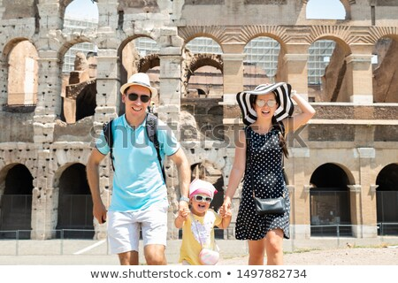 Young Family Running In Front Of Colosseum Stock photo © AndreyPopov