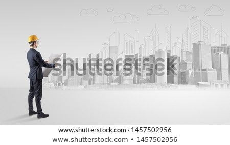 Architect standing and replanning a city panorama Stock photo © ra2studio