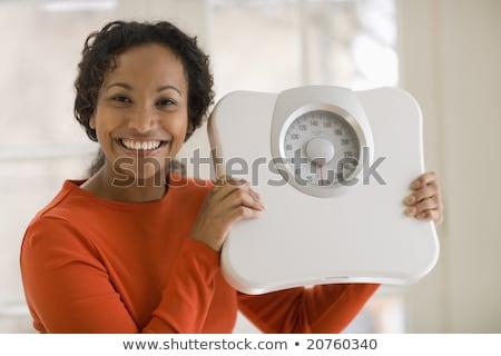 Gelukkig zwarte vrouw met schaal Stockfoto © EdBockStock