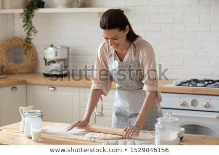 smiling woman with rolling pin preparing dough stock photo © rob_stark
